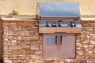 Built in outdoor grill with natural stacked stone surround