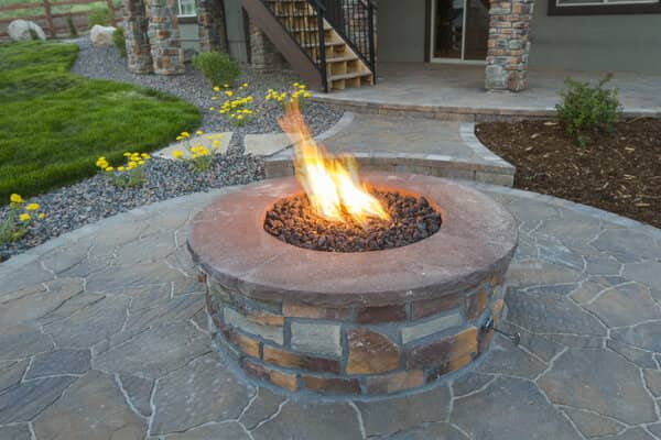 Built in gas stone fire pit with stone paver pation