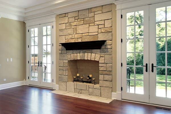 Modern stone mantel fireplace and hearth